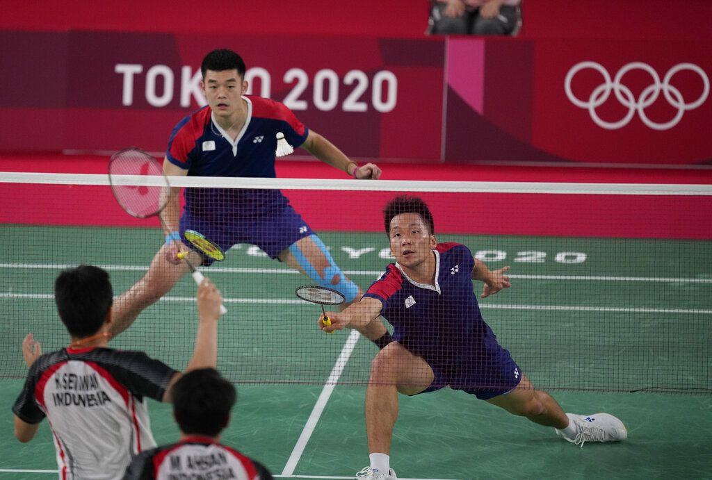 Taiwan's Lee Yang and Wang Chi-Lin play against Indonesia's Mohammad Ahsan and Hendra Setiawan during their men's doubles badminton semifinal match at the 2020 Summer Olympics, Friday, July 30, 2021, in Tokyo, Japan. (AP Photo/Dita Alangkara)