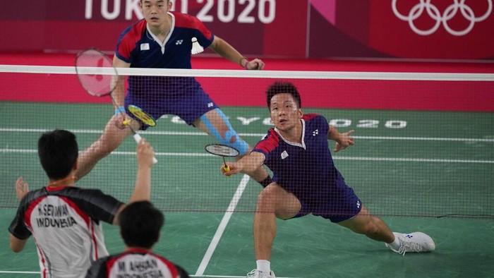Taiwans Lee Yang and Wang Chi-Lin play against Indonesias Mohammad Ahsan and Hendra Setiawan during their mens doubles badminton semifinal match at the 2020 Summer Olympics, Friday, July 30, 2021, in Tokyo, Japan. (AP Photo/Dita Alangkara)