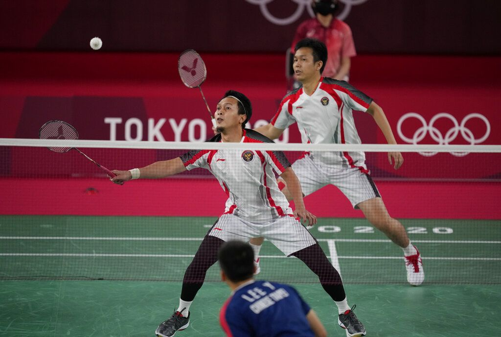 Indonesia's Mohammad Ahsan and Hendra Setiawan compete against Taiwan's Lee Yang and Wang Chi-Lin during their men's doubles badminton semifinal match at the 2020 Summer Olympics, Friday, July 30, 2021, in Tokyo, Japan. (AP Photo/Dita Alangkara)