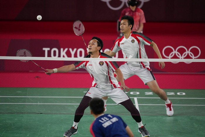 Indonesias Mohammad Ahsan and Hendra Setiawan compete against Taiwans Lee Yang and Wang Chi-Lin during their mens doubles badminton semifinal match at the 2020 Summer Olympics, Friday, July 30, 2021, in Tokyo, Japan. (AP Photo/Dita Alangkara)