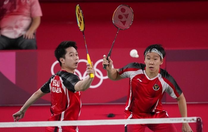 Indonesias Marcus Gideon and Kevin Sanjaya Sukamuljo play against Taiwans Lee Yang and Wang Chi-Lin during their mens doubles group play stage badminton match at the 2020 Summer Olympics, Tuesday, July 27, 2021, in Tokyo, Japan. (AP Photo/Dita Alangkara)
