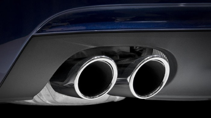 Chrome exhaust pipes on a blue car.