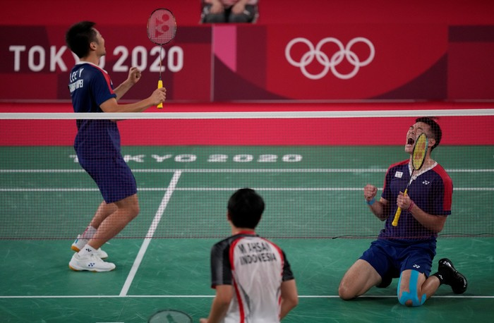 Taiwans Lee Yang, left, and Wang Chi-Lin celebrate after wining against Indonesias Mohammad Ahsan and Hendra Setiawan during their mens doubles badminton semifinal match at the 2020 Summer Olympics, Friday, July 30, 2021, in Tokyo, Japan. (AP Photo/Dita Alangkara)