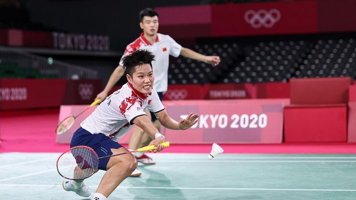 CHOFU, JAPAN - JULY 30: Wang Yi Lyu and Huang Dong Ping(front) of Team China compete against Zheng Si Wei and Huang Ya Qiong of Team China during the Mix Doubles Gold Medal match on day seven of the Tokyo 2020 Olympic Games at Musashino Forest Sport Plaza on July 30, 2021 in Chofu, Tokyo, Japan. (Photo by Lintao Zhang/Getty Images)