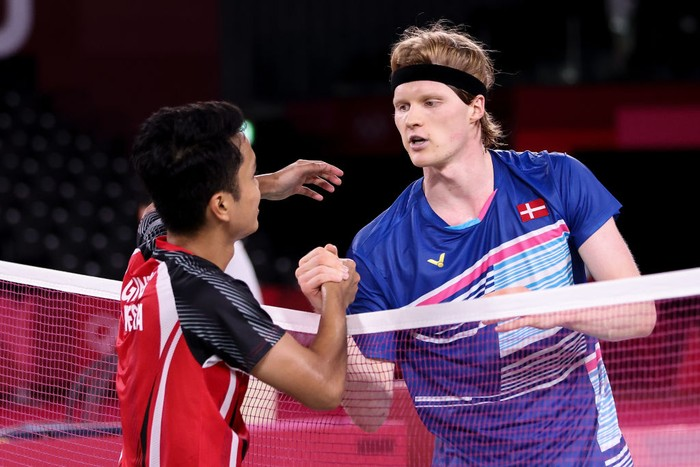 CHOFU, JAPAN - JULY 31: Anthony Sinisuka Ginting(left) of Team Indonesia greets his opponent Anders Antonsen of Team Denmark after a Mens Singles Quarterfinal match on day eight of the Tokyo 2020 Olympic Games at Musashino Forest Sport Plaza on July 31, 2021 in Chofu, Tokyo, Japan. (Photo by Lintao Zhang/Getty Images)
