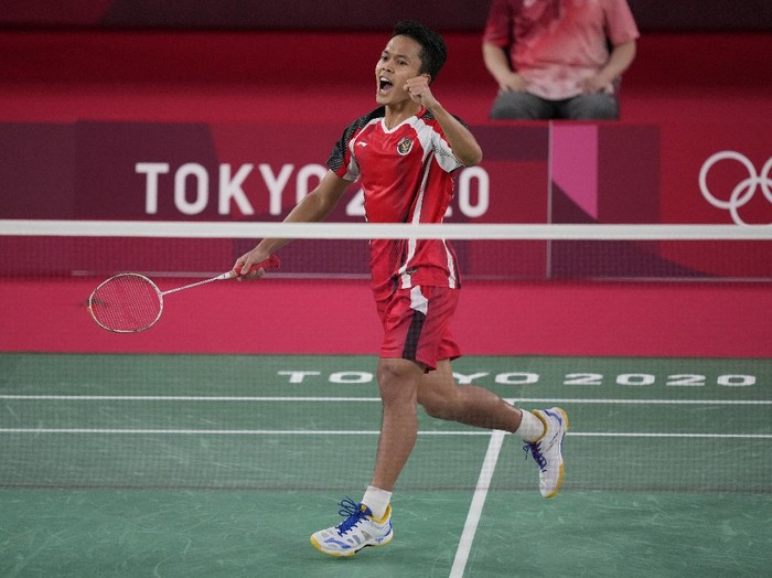 Indonesias Anthony Sinisuka Ginting celebrates after defeating Anders Antonsen of Denmark during their mens singles badminton quarterfinal match at the 2020 Summer Olympics, Saturday, July 31, 2021, in Tokyo, Japan. (AP Photo/Dita Alangkara)