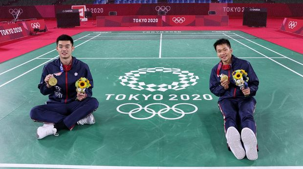 CHOFU, JAPAN - JULY 31: Gold medalists of Men's Doubles badminton event Lee Yang(right) and Wang Chi-Lin of Team Chinese Taipei pose for photo on day eight of the Tokyo 2020 Olympic Games at Musashino Forest Sport Plaza on July 31, 2021 in Chofu, Tokyo, Japan. (Photo by Lintao Zhang/Getty Images)