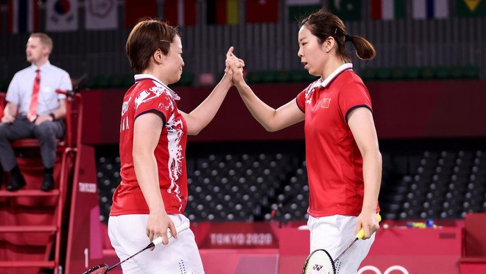 CHOFU, JAPAN - JULY 31: Chen Qing Chen(left) and Jia Yi Fan of Team China celebrate as they win against Kim Soyeong and Kong Heeyong of Team South Korea during a Women's Doubles Semi-final match on day eight of the Tokyo 2020 Olympic Games at Musashino Forest Sport Plaza on July 31, 2021 in Chofu, Tokyo, Japan. (Photo by Lintao Zhang/Getty Images)