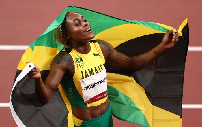 TOKYO, JAPAN - JULY 31: Elaine Thompson-Herah of Team Jamaica celebrates after winning the gold medal in the Womens 100m Final on day eight of the Tokyo 2020 Olympic Games at Olympic Stadium on July 31, 2021 in Tokyo, Japan. (Photo by David Ramos/Getty Images)