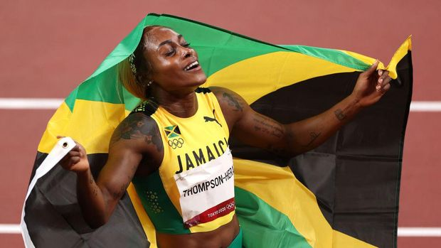 TOKYO, JAPAN - JULY 31: Elaine Thompson-Herah of Team Jamaica celebrates after winning the gold medal in the Women's 100m Final on day eight of the Tokyo 2020 Olympic Games at Olympic Stadium on July 31, 2021 in Tokyo, Japan. (Photo by David Ramos/Getty Images)