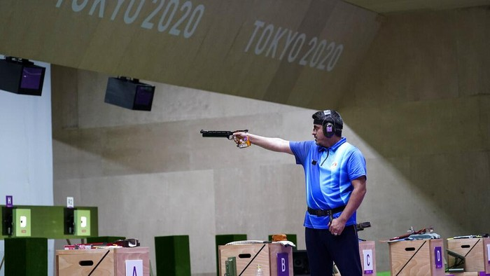 Javad Foroughi, of Iran, competes in the mens 10-meter air pistol at the Asaka Shooting Range in the 2020 Summer Olympics, Saturday, July 24, 2021, in Tokyo, Japan. Foroughi went on to win the gold medal. (AP Photo/Alex Brandon)