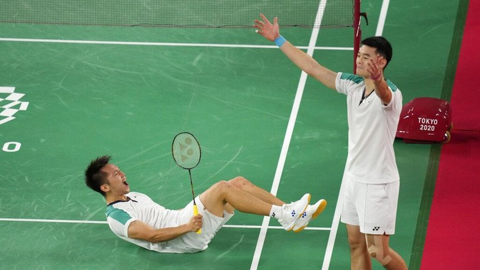 Taiwans Wang Chi-Lin, left, and Lee Yang, center, celebrate after winning against Chinas Li Jun Hui and Liu Yu Chen during their mens doubles gold medal Badminton match at the 2020 Summer Olympics, Saturday, July 31, 2021, in Tokyo, Japan. (AP Photo/Markus Schreiber)