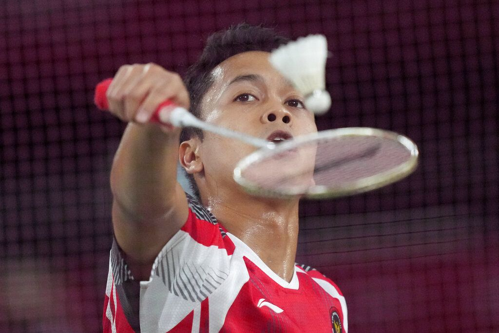Indonesia's Anthony Sinisuka Ginting competes against China's Chen Long during their men's singles badminton semifinal match at the 2020 Summer Olympics, Sunday, Aug. 1, 2021, in Tokyo, Japan. (AP Photo/Dita Alangkara)