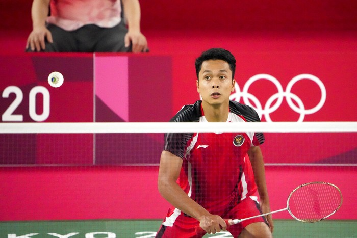 Indonesias Anthony Sinisuka Ginting competes against Chinas Chen Long during their mens singles badminton semifinal match at the 2020 Summer Olympics, Sunday, Aug. 1, 2021, in Tokyo, Japan. (AP Photo/Markus Schreiber)