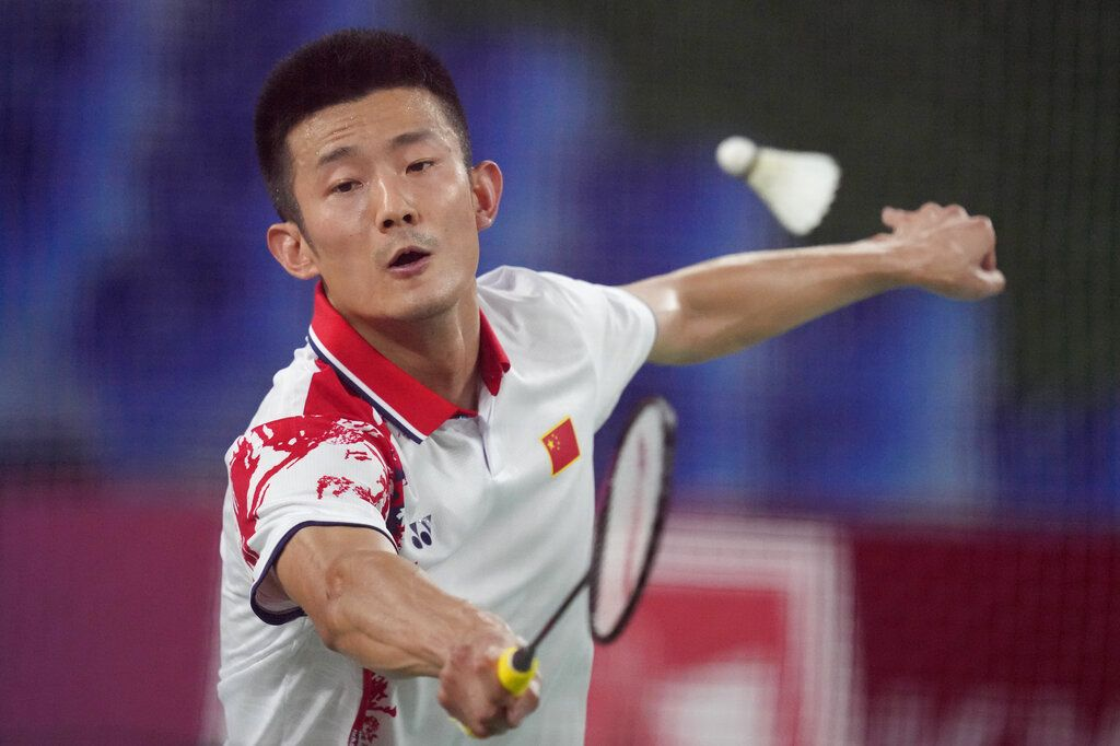 China's Chen Long celebrates after scoring a point against Indonesia's Anthony Sinisuka Ginting during their men's singles badminton semifinal match at the 2020 Summer Olympics, Sunday, Aug. 1, 2021, in Tokyo, Japan. (AP Photo/Dita Alangkara)