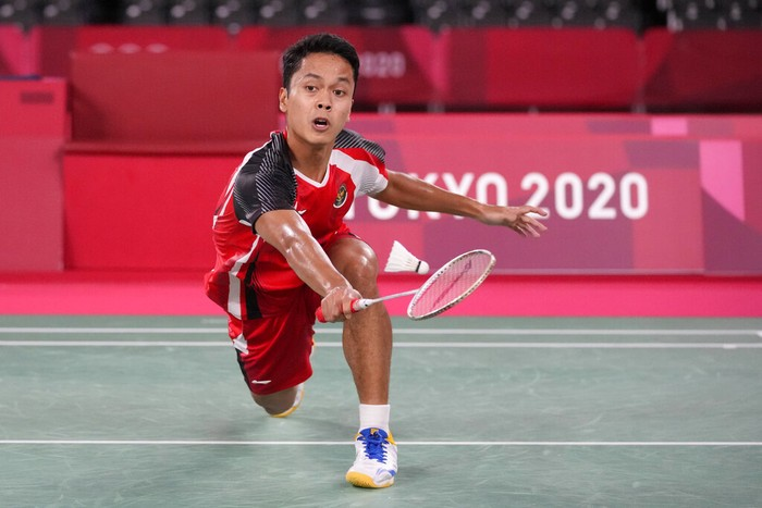 Indonesias Anthony Sinisuka Ginting competes against Chinas Chen Long during their mens singles badminton semifinal match at the 2020 Summer Olympics, Sunday, Aug. 1, 2021, in Tokyo, Japan. (AP Photo/Dita Alangkara)