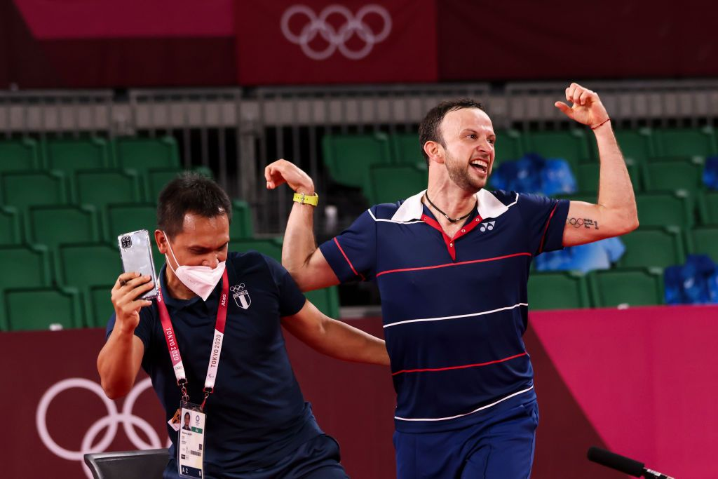 CHOFU, JAPAN - JULY 29: Kevin Cordon of Team Guatemala celebrates with his coach Muamar Qadafi(left) after his victory against Mark Caljouw of Team Netherlands during a Men's Singles Round of 16 match on day six of the Tokyo 2020 Olympic Games at Musashino Forest Sport Plaza on July 29, 2021 in Chofu, Tokyo, Japan. (Photo by Lintao Zhang/Getty Images)