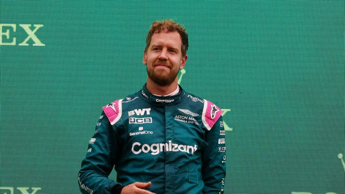 BUDAPEST, HUNGARY - AUGUST 01: Second placed Sebastian Vettel of Germany and Aston Martin F1 Team celebrates on the podium during the F1 Grand Prix of Hungary at Hungaroring on August 01, 2021 in Budapest, Hungary. (Photo by Florion Goga - Pool/Getty Images)