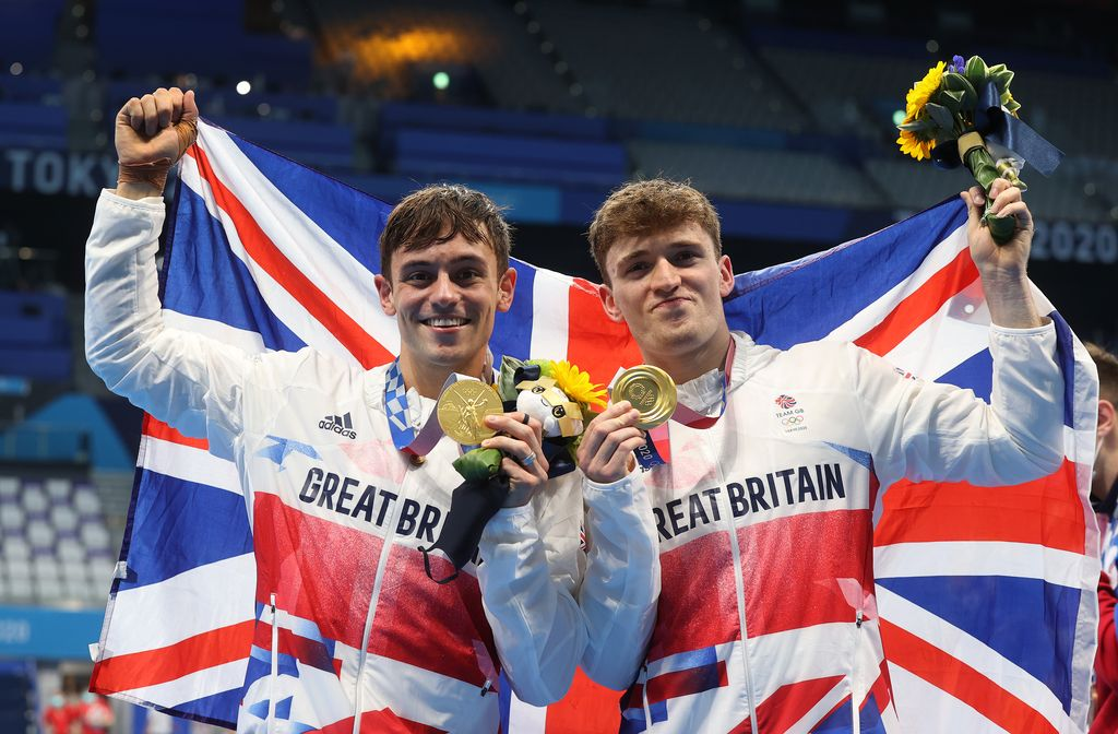 TOKYO, JAPAN - JULY 26: Thomas Daley and Matty Lee of Team Great Britain pose for photographers with their gold medals after winning the Men's Synchronised 10m Platform Final on day three of the Tokyo 2020 Olympic Games at Tokyo Aquatics Centre on July 26, 2021 in Tokyo, Japan. (Photo by Clive Rose/Getty Images)