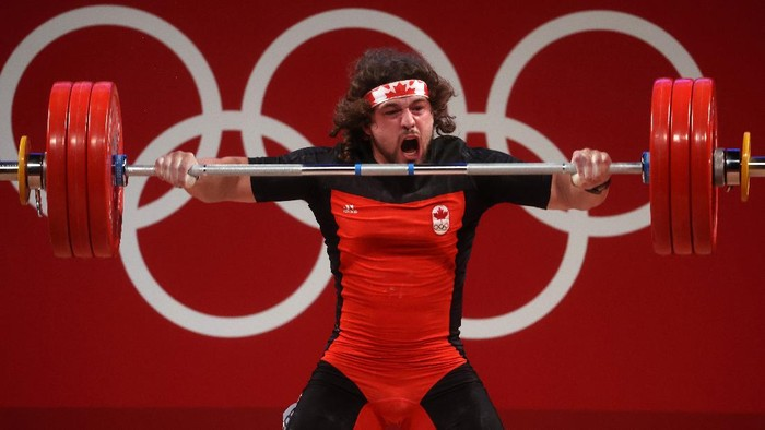 TOKYO, JAPAN - JULY 31: Boady Robert Santavy of Team Canada competes during the Weightlifting - Mens 96kg Group A on day eight of the Tokyo 2020 Olympic Games at Tokyo International Forum on July 31, 2021 in Tokyo, Japan. (Photo by Chris Graythen/Getty Images)