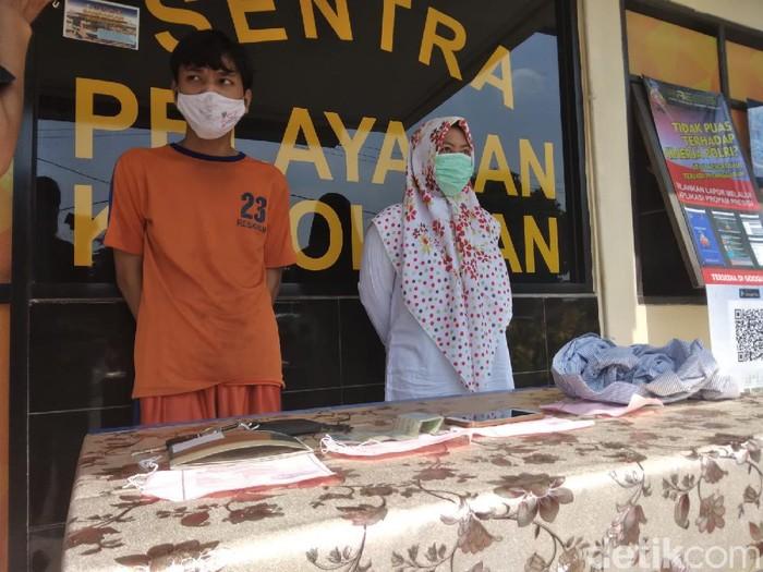 Pasutri asal Banjarnegara ini nekat begal sopir taksi online di Karawang