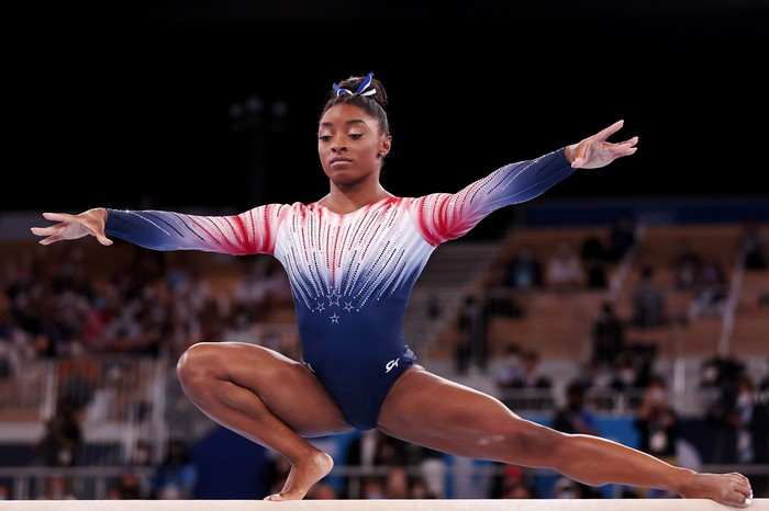 TOKYO, JAPAN - AUGUST 03: Simone Biles of Team United States competes in the Womens Balance Beam Final on day eleven of the Tokyo 2020 Olympic Games at Ariake Gymnastics Centre on August 03, 2021 in Tokyo, Japan. (Photo by Laurence Griffiths/Getty Images)