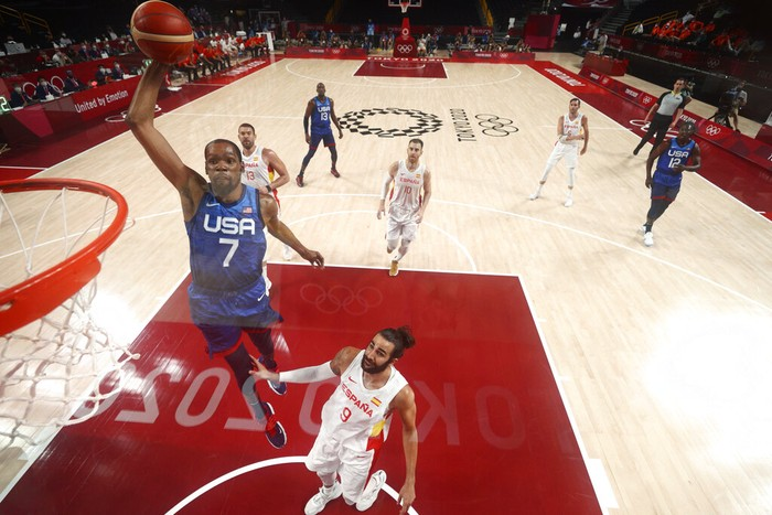 United States' Kevin Durant (7) drives to the basket over Spain's Ricky Rubio (9) during a men's basketball quarterfinal round game at the 2020 Summer Olympics, Tuesday, Aug. 3, 2021, in Saitama, Japan. (Gregory Shamus/Pool Photo via AP)