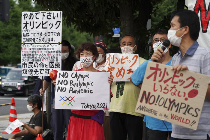Protesters demonstrate in front of the Prime Minister's Office in Tokyo, Japan, Monday, Aug. 2, 2021. They were protesting against the Olympics and Paralympics held during the pandemic as Japan has expanded a coronavirus state of emergency to Tokyo's neighboring prefectures in addition to the capital, following recent record spikes in infections. (AP Photo/Kantaro Komiya)