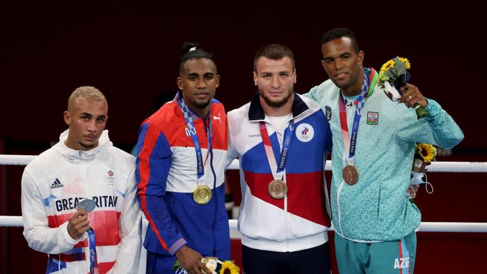 TOKYO, JAPAN - AUGUST 04: Men's Light Heavy (75-81kg) medalists (L-R) Benjamin Whittaker of Team Great Britain (silver medal), Arlen Lopez of Team Cuba (gold medal), Imam Khataev of Team Russian Olympic Committee (bronze medal) and Loren Berto Alfonso Dominguez of Team Azerbaijan (bronze medal) pose for photographs during the Victory Ceremony on day twelve of the Tokyo 2020 Olympic Games at Kokugikan Arena on August 04, 2021 in Tokyo, Japan. (Photo by Harry How/Getty Images)