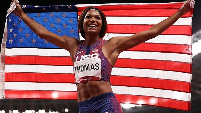 TOKYO, JAPAN - AUGUST 03: Gabrielle Thomas of Team United States celebrates with her countries flag after winning the bronze medal in the Womens 200m Final on day eleven of the Tokyo 2020 Olympic Games at Olympic Stadium on August 03, 2021 in Tokyo, Japan. (Photo by David Ramos/Getty Images)