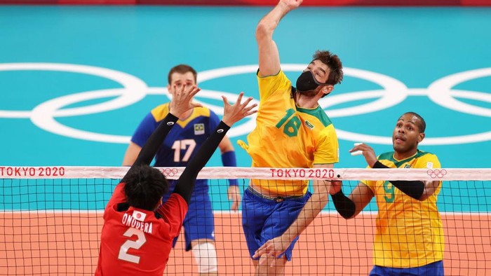 TOKYO, JAPAN - AUGUST 03: Lucas Saatkamp #16 of Team Brazil hits the ball against Team Japan during the Mens Quarterfinals volleyball on day eleven of the Tokyo 2020 Olympic Games at Ariake Arena on August 03, 2021 in Tokyo, Japan. (Photo by Toru Hanai/Getty Images)