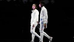 Makna Mendalam di Balik Masker Pink Pemain Anggar AS di Olimpiade