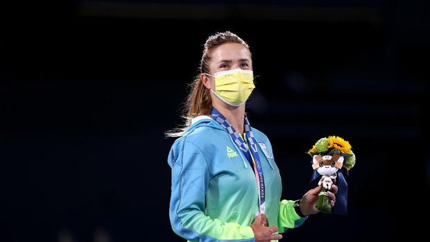 TOKYO, JAPAN - JULY 31: Bronze medalist Elina Svitolina of Team Ukraine looks on from the podium during the medal ceremony after the Women's Singles Gold Medal match on day eight of the Tokyo 2020 Olympic Games at Ariake Tennis Park on July 31, 2021 in Tokyo, Japan. (Photo by Naomi Baker/Getty Images)