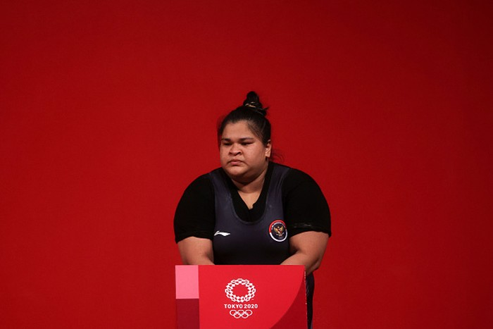 TOKYO, JAPAN - AUGUST 02: Nurul Akmal of Team Indonesia competes during the Weightlifting - Women's 87kg+ Group A on day ten of the Tokyo 2020 Olympic Games at Tokyo International Forum on August 02, 2021 in Tokyo, Japan. (Photo by Chris Graythen/Getty Images)