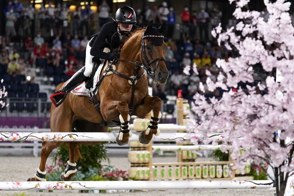 Britain's Harry Charles, riding Romeo 88, competes during the equestrian jumping individual qualifying at Equestrian Park in Tokyo at the 2020 Summer Olympics, Tuesday, Aug. 3, 2021, in Tokyo, Japan. (AP Photo/Carolyn Kaster)