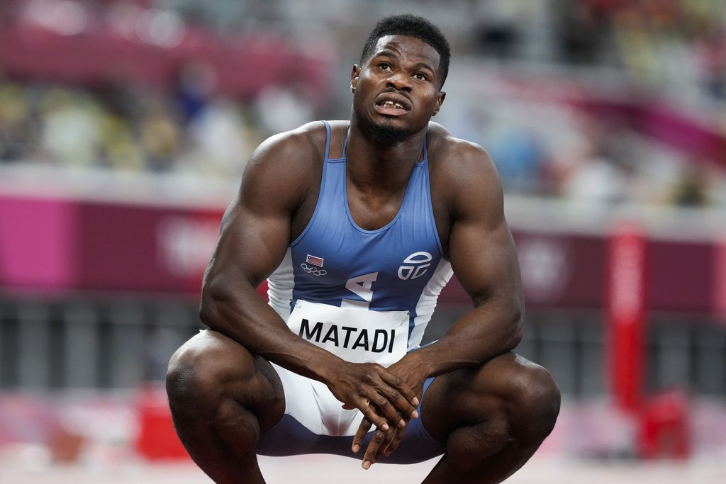 Emmanuel Matadi, of Liberia, reacts after a heat in the men's 100-meter run at the 2020 Summer Olympics, Saturday, July 31, 2021, in Tokyo. (AP Photo/Martin Meissner)