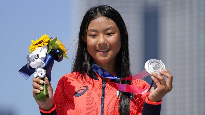 Silver medalist Kokona Hiraki of Japan poses during the medals ceremony for the womens park skateboarding finals at the 2020 Summer Olympics, Wednesday, Aug. 4, 2021, in Tokyo, Japan. (AP Photo/Ben Curtis)
