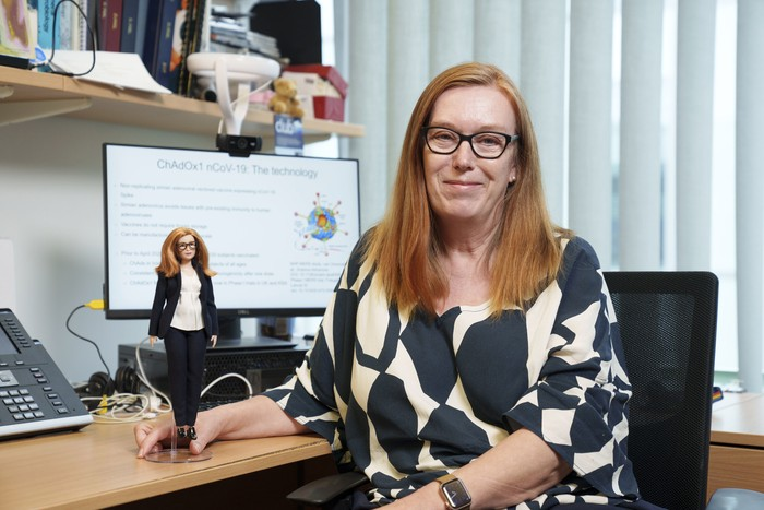 In this undated photo issued by Mattel, Britains Professor Sarah Gilbert holds a Barbie doll made in her image, in honour of the Oxford vaccine co-creator. The toy company has created models in honour of five other women working in STEM around the world. (Andy Paradise/Mattel via AP)