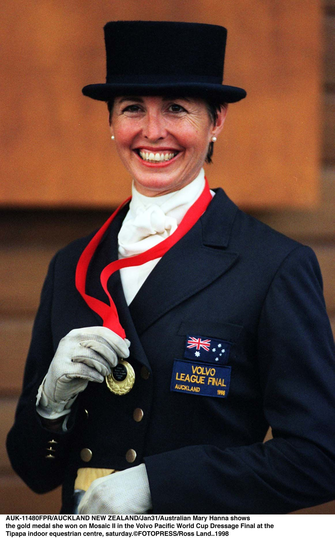 AUCKLAND, NEW ZEALAND - JANUARY 31:  Australian Mary Hanna shows rthe gold medal she won on Mosaic II in the Volvo Pacific World Cup Dressage Final at the rTipapa indoor equestrian centre, saturday.  (Photo by Ross Land/Getty Images)