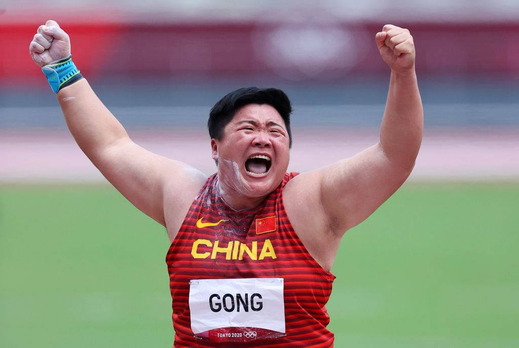 TOKYO, JAPAN - AUGUST 01: Lijiao Gong of Team China celebrates with the gold medal during the medal ceremony for the Women's Shot Put on day nine of the Tokyo 2020 Olympic Games at Olympic Stadium on August 01, 2021 in Tokyo, Japan. (Photo by Ryan Pierse/Getty Images)