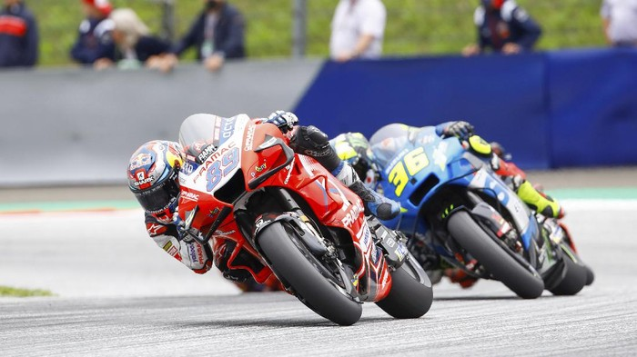 Pramac Ducati rider Jorge Martin of Spain foreground left, and Ecstar Suzuki rider Joan Mir of Spain lead the pack during the Grand Prix of Styria at the Red Bull Ring in Spielberg, Austria, Sunday, Aug. 8, 2021. (AP Photo/Gerhard Schiel)