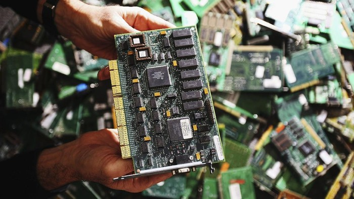 SYDNEY, AUSTRALIA - JUNE 04:  Tony Domanski, Operations manager IT and Infrastructure for the Reverse Garbage Co-Op poses with printed circuit boards from a computer undergoing recycling June 4, 2007 in Sydney Australia. Modern machines such as computers and personal entertainment devices are being recycled by the Co-Op in Sydney's West, preventing them from ending up in landfill sites. The mother-boards and other usable materials are removed and re-used in re-built machines, and also sold on to artists for artwork. The so-called