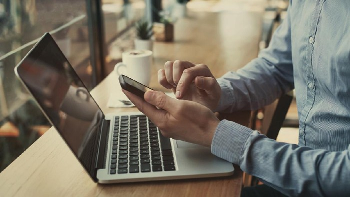 social media, closeup of hands holding smartphone in cafe, banking online, businessman with mobile internet