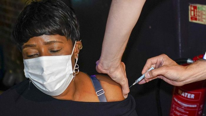 Drag queen Baga Chips, real name Leo Loren, receives a Pfizer vaccine shot at a pop-up Covid vaccination centre, set up at Heaven night club in London, Sunday, Aug. 8, 2021. Londons Heaven club has become the UKs first nightclub to be turned into a pop-up Coronavirus vaccination centre, as authorities try to attract younger people to get vaccinated. (AP Photo/Alberto Pezzali)