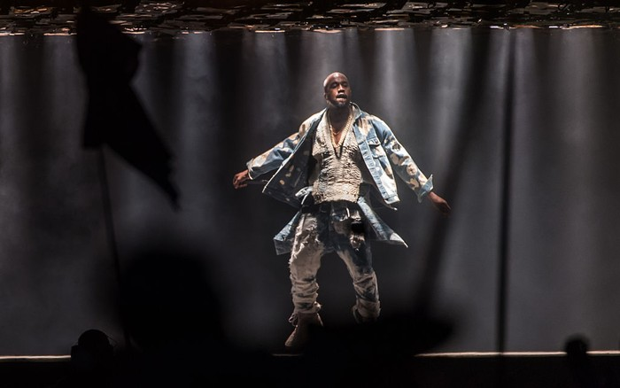 GLASTONBURY, ENGLAND - JUNE 27: Kanye West performs on The Pyramid Stage during the Glastonbury Festival at Worthy Farm, Pilton on June 27, 2015 in Glastonbury, England.  Now its 45th year the festival is one largest music festivals in the world and this year features headline acts Florence and the Machine, Kanye West and The Who. The Festival, which Michael Eavis started in 1970 when several hundred hippies paid just £1, now attracts more than 175,000 people.  (Photo by Ian Gavan/Getty Images)
