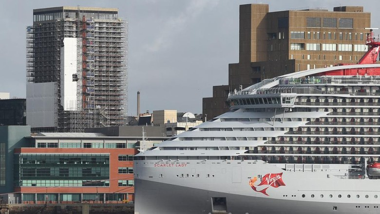 The Virgin Voyages cruise ship Scarlet Lady is seen on the River Mersey in Liverpool on February 26, 2020. - Sailing from its intended home port of Miami, Florida, Scarlet Lady is Virgin Voyages first luxury cruise ship and is set to start operating from April 2020 on routes from Florida around the Carribean. (Photo by Paul ELLIS / AFP)