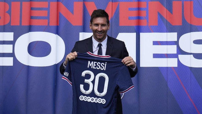 Lionel Messi holds his jersey after a press conference Wednesday, Aug. 11, 2021 at the Parc des Princes stadium in Paris. Lionel Messi said hes been enjoying his time in Paris since the first minute after he signed his Paris Saint-Germain contract on Tuesday night. The 34-year-old Argentina star signed a two-year deal with the option for a third season after leaving Barcelona. (AP Photo/Francois Mori)