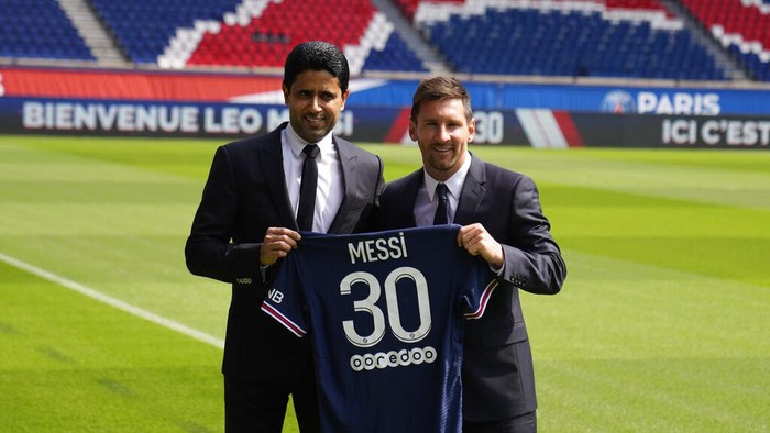 Lionel Messi, right, and PSG president Nasser Al-Al-Khelaifi hold Messis jersey Wednesday, Aug. 11, 2021 at the Parc des Princes stadium in Paris. Lionel Messi said hes been enjoying his time in Paris