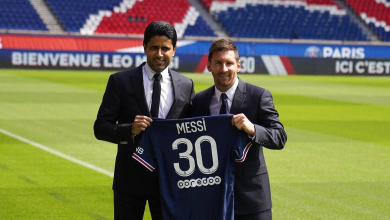 Lionel Messi, right, and PSG president Nasser Al-Al-Khelaifi hold Messis jersey Wednesday, Aug. 11, 2021 at the Parc des Princes stadium in Paris. Lionel Messi said hes been enjoying his time in Paris since the first minute after he signed his Paris Saint-Germain contract on Tuesday night. The 34-year-old Argentina star signed a two-year deal with the option for a third season after leaving Barcelona. (AP Photo/Francois Mori)