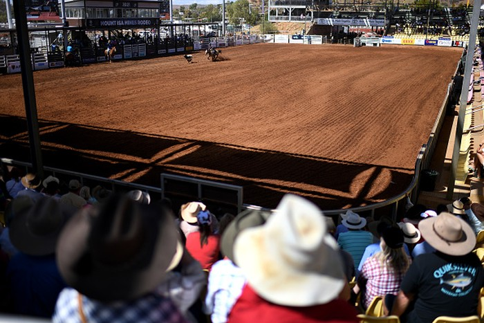 MOUNT ISA, AUSTRALIA - AUGUST 13: Spectators watch events at the Mount Isa Mines Rodeo on August 13, 2021 in Mount Isa, Australia. Established in 1959, the Mount Isa Rodeo is the richest in the southern hemisphere and attracts contestants from all parts of the world. (Photo by Dan Peled/Getty Images)